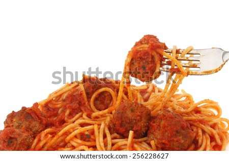 Closeup of spaghetti and meatballs on a fork against a white background - stock photo