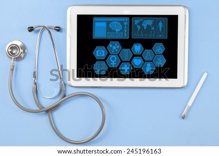 Closeup of stethoscope with medical icons on the digital tablet screen and stylus pen - stock photo