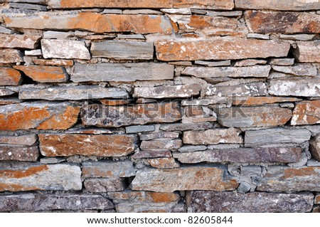 Closeup of stone wall use for construction business and designers - stock photo