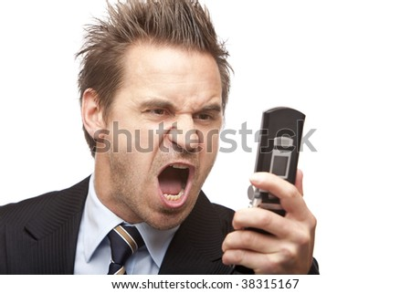Closeup of stressed businessman holding a mobile phone and screams into it. Isolated on white background - stock photo
