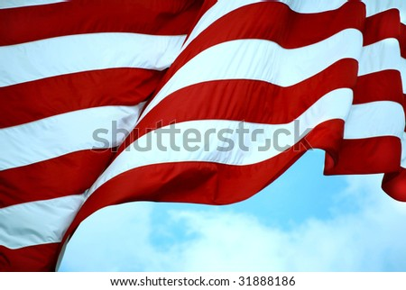 Closeup of Stripes on American Flag Waving in the Wind - stock photo