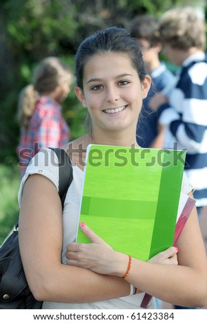 Closeup of student standing outside - stock photo