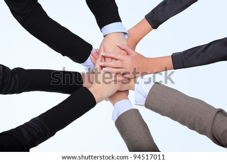 Closeup of successful business women with their hands together - stock photo