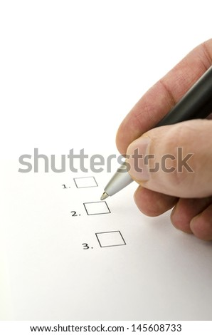 Closeup of survey and consumer hand choosing one of three options. - stock photo
