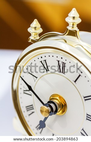 Closeup of table period clock with oscillating mechanism  - stock photo
