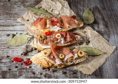 closeup of tasty appetizers on wooden rustic background - stock photo