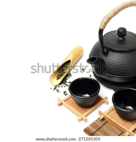 Closeup of tea set on white background  - stock photo