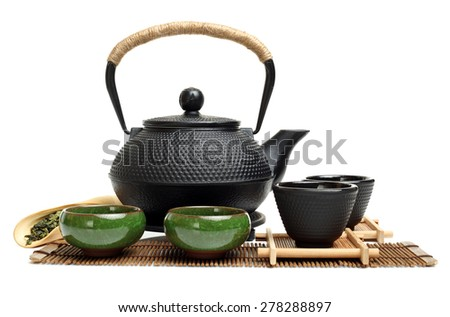 Closeup of tea set on white background  - stock photo