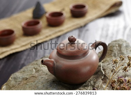 Closeup of teapot on table with four cups, Chinese tea culture - stock photo