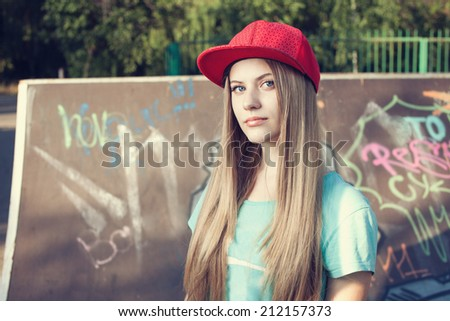 Closeup of teen girl on playground - stock photo