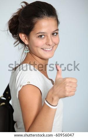Closeup of teenage girl with thumb up - stock photo