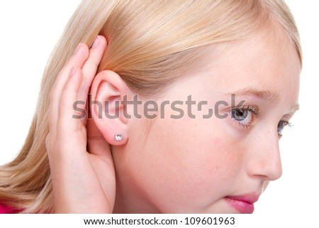 Closeup of teens ear, hand to ear listening isolated on white - stock photo