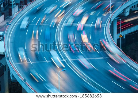 closeup of the curve lanes with car motion blur - stock photo