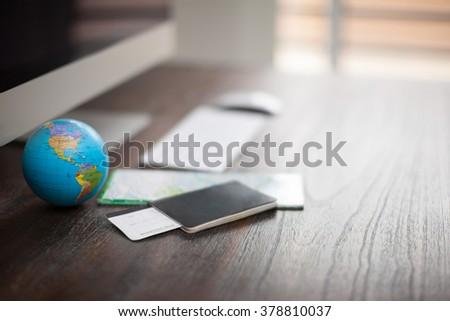 Closeup of the desk of a world traveler with a passport, plane tickets and a map. Photo with shallow depth of field - stock photo