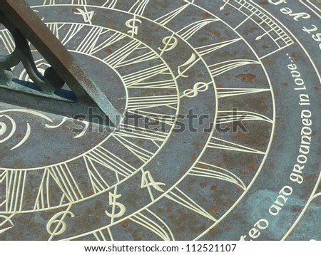 Closeup of the face of an old sundial. - stock photo