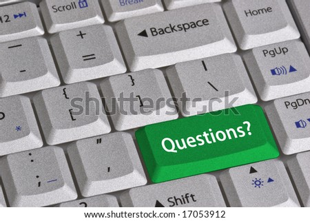 Closeup of the grey textured keys of a modern laptop computer keyboard.  One green colored key that is labeled QUESTIONS?. - stock photo