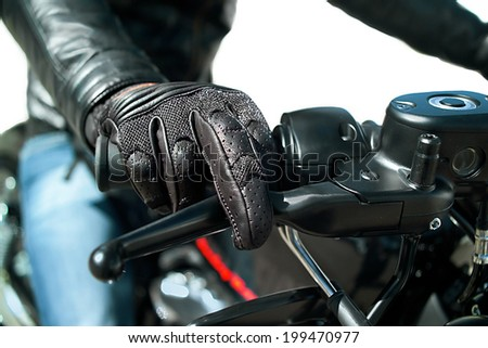 Closeup of the Hand of motorcyclist in protective glove on a throttle control, isolated on white - stock photo