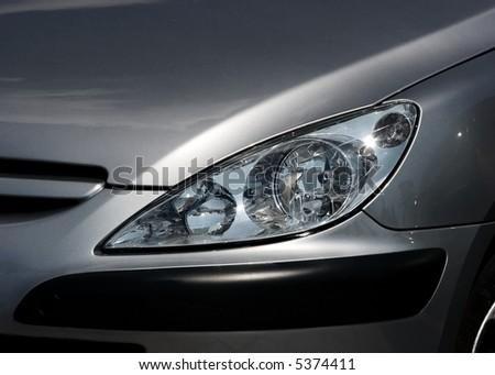 Closeup of the headlights of a car - stock photo
