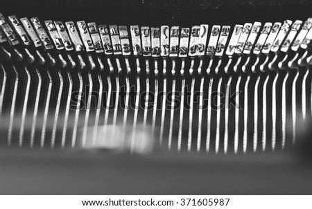closeup of the letters on an old typewriter - stock photo