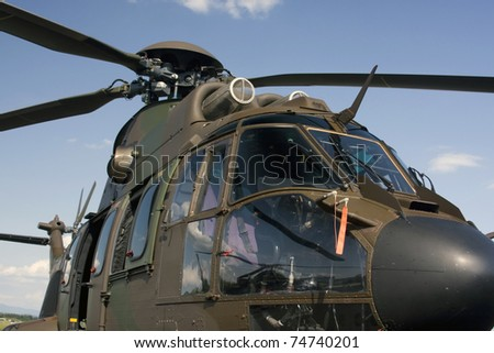 Closeup of the military helicopter cabin. - stock photo