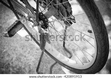 Closeup of the old and rusty bicycle chain, black and white tone filter. - stock photo
