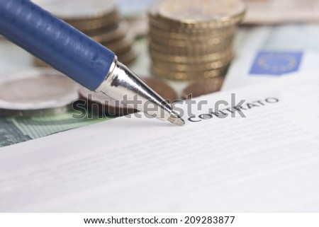 Closeup of the pen and contract leaf coins - stock photo