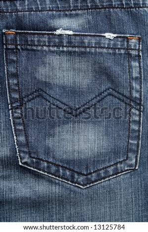 Closeup of the pocket on the blue jeans - stock photo