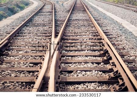 closeup of the railway track ,train line crossing  - stock photo