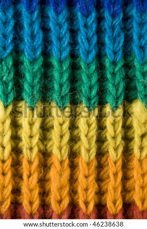 Closeup of the texture of a rainbow scarf - stock photo