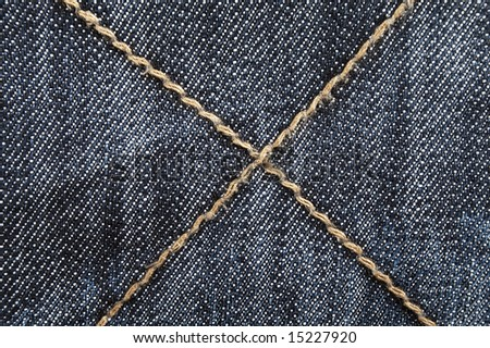 Closeup of the texture of the blue jeans - stock photo