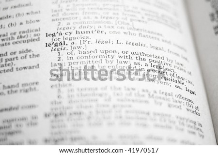 closeup of the word Legal in a dictionary - stock photo