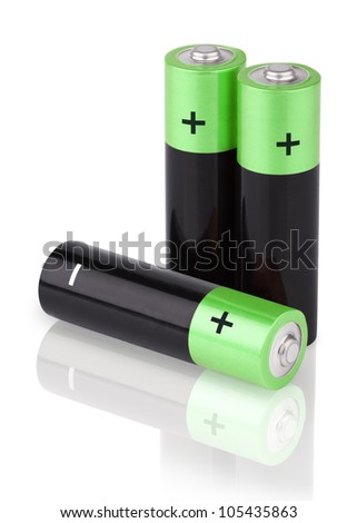 Closeup of three AA batteries isolated on white background - stock photo