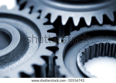 Closeup of three gears - stock photo