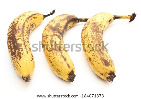 Closeup of three overripe and old bananas isolated on white background - stock photo
