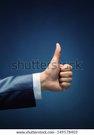 Closeup of thumbs up symbol - stock photo