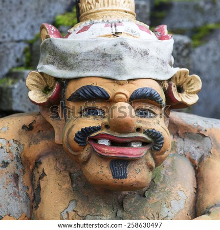 Closeup of traditional Balinese God statue in Central Bali temple - stock photo