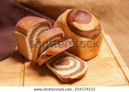 Closeup of traditional Homemade Marble Cake. Isolated on cutting board. - stock photo