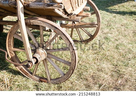 Closeup of trolley wooden wheel with copy space - stock photo