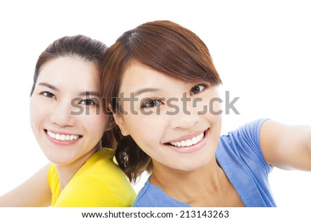 closeup of two happy young girls over white background - stock photo