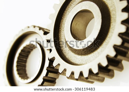 Closeup of two metal cog gears - stock photo
