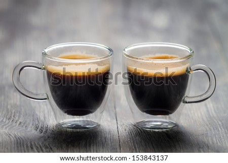 Closeup of two small cups with espresso - stock photo