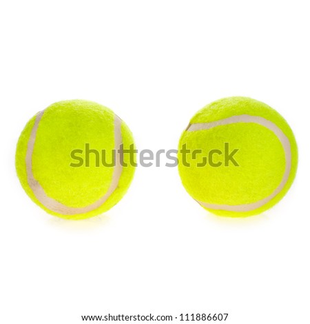 Closeup of two tennis balls isolated on white background. - stock photo