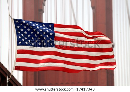 Closeup of U.S. flag in front of the Golden Gate Bridge in San Francisco - stock photo
