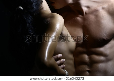 Closeup of undressed sensual couple of man with beautiful muscular wet body with six-pack embracing young lady with bare chest standing close to each other, horizontal picture - stock photo