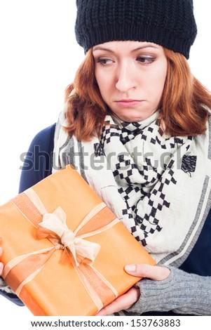 Closeup of unhappy sad woman holding present. - stock photo