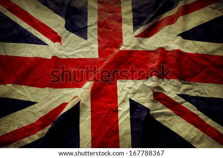 Closeup of Union Jack flag, with texture - stock photo
