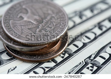 Closeup of USA coins and one dollar bank notes - stock photo