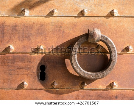 Closeup of vintage lock and iron door - stock photo