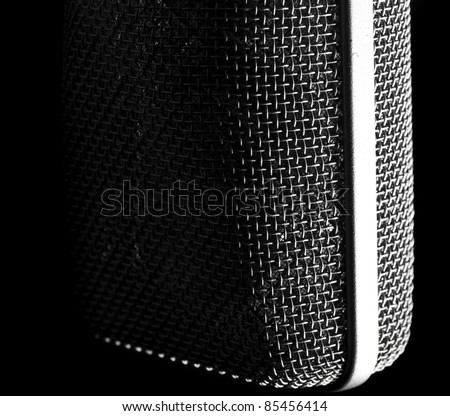 closeup of vintage microphone on black background - stock photo