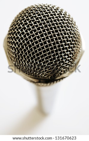 closeup of vintage microphone over white background - stock photo